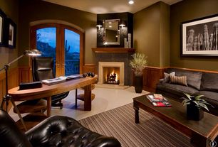 Traditional Home Office with sandstone tile floors, Wainscotting, French doors, Wall sconce, Ceiling fan, stone fireplace