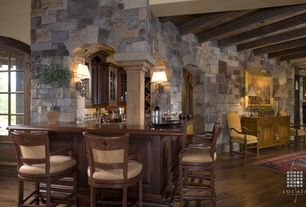 Country Bar with Built-in bookshelf, Columns, Hardwood floors, Wall sconce, Exposed beam, Archway, Glass panel door