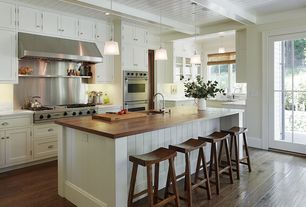 Traditional Kitchen with Kitchen island, electric cooktop, full backsplash, Wood counters, French doors, U-shaped, Wall Hood