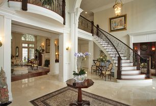 Traditional Staircase with Hardwood floors, curved staircase, High ceiling, Crown molding