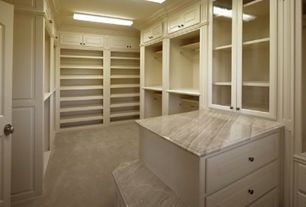 Traditional Closet with Skylight, Built-in bookshelf, Oregon tile & marble in daino reale, Concrete floors