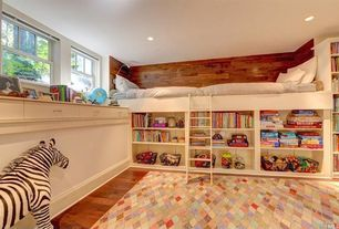 Cottage Kids Bedroom with Momeni mud hut diamond rug 8'x10', Built-in bookshelf, Paint, Standard height, double-hung window