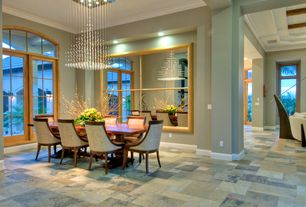 Contemporary Dining Room with Crown molding, Daltile Slate Collection Autumn Mist, travertine floors, Arched window
