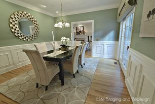 Contemporary Dining Room with Wainscotting, Hardwood floors, Crown molding, Standard height, sliding glass door, Chandelier
