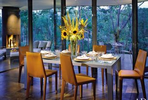Contemporary Dining Room with French doors, sandstone tile floors