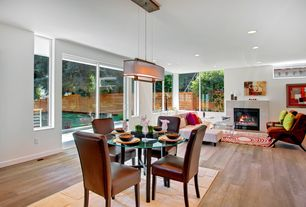 Contemporary Great Room with Hardwood floors, Pendant light, stone fireplace
