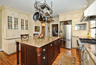 Traditional Kitchen with Kitchen island, Crown molding, European Cabinets, Flush, Wall Hood, Multiple Refrigerators, U-shaped