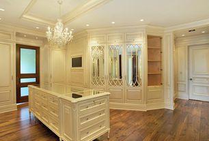 Traditional Closet with can lights, Built-in bookshelf, Chandelier, Standard height, Hardwood floors, specialty door
