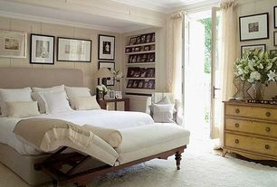 Contemporary Master Bedroom with Built-in bookshelf, Carpet, Exposed beam, French doors, Scrollback chaise chair