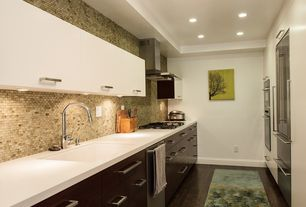 Contemporary Kitchen with Corian counters, can lights, Paint, Ceramic Tile, Galley, full backsplash, Undermount sink, Flush