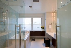 Contemporary Master Bathroom with Flush, Corian counters, Vessel sink, European Cabinets, Handheld showerhead