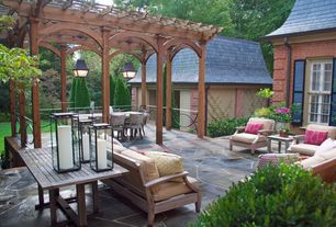 Traditional Patio with Pathway, Deck Railing, Outdoor seating area, Trellis, exterior stone floors, Exterior brick wall