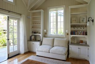 Cottage Master Bedroom with Wall sconce, Built-in bookshelf, Circa Lighting Small Aspect Articulating Sconce, Paint 1