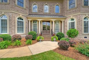 Traditional Front Door with exterior tile floors, French doors, exterior concrete tile floors, Deck Railing, Arched window