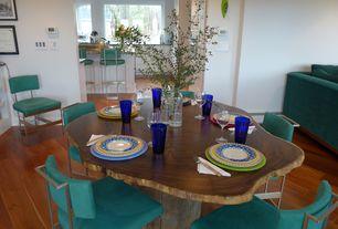 Eclectic Dining Room with Built-in bookshelf, Standard height, Hardwood floors