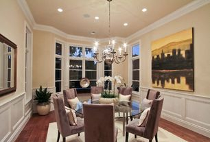 Traditional Dining Room with Chandelier, French doors, Wainscotting, Hardwood floors, Crown molding