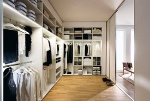 Contemporary Closet with Built-in bookshelf, Shoji door, Hardwood floors