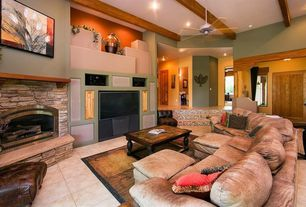 Craftsman Living Room with Ceiling fan, can lights, stone tile floors, Exposed beam, Standard height, Paint 2, specialty door