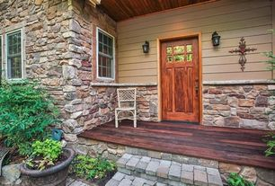 Craftsman Exterior of Home with Cobblestone, double-hung window, Horizontal wood plank porch, Paint