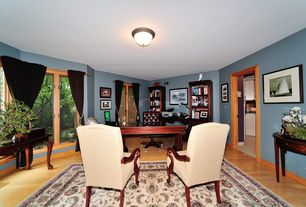 Craftsman Home Office with Laminate floors, Built-in bookshelf, flush light