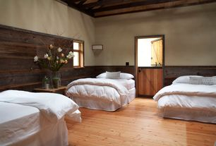 Cottage Guest Bedroom with double-hung window, Hardwood floors, Wainscotting, High ceiling, Dutch door, Exposed beam