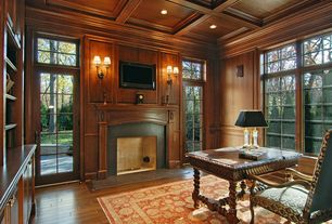 Traditional Home Office with French doors, Wood panel ceiling, Built-in bookshelf, Transom window, Wood panel wall, Area rug