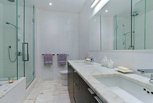 Contemporary Master Bathroom with Kohler Verticyl Rectangular undermount bathroom sink, European Cabinets, Rain shower, Flush