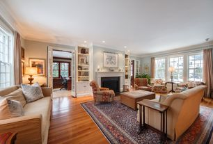 Traditional Living Room with Cement fireplace, French doors, Crown molding, Built-in bookshelf, Hardwood floors