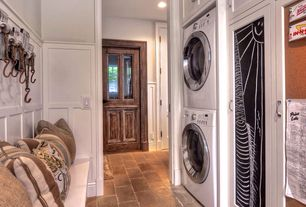 Traditional Mud Room with High ceiling, Built-in bookshelf, Lg compact ventless dryer, Glass panel door, Wainscotting