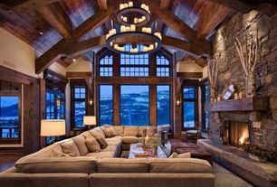 Country Living Room with Built-in bookshelf, Architect Series Casement Window, Wall sconce, Exposed beam, Laminate floors