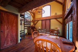 Rustic Living Room with Columns, High ceiling, Exposed beam, Arched window, Chandelier, Hardwood floors