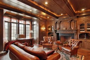 Traditional Home Office with Fireplace, insert fireplace, Exposed beam, Standard height, picture window, can lights