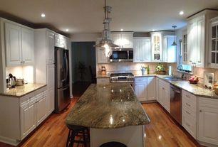 Traditional Kitchen with Complex granite counters, Multiple Sinks, U-shaped, Stone Tile, Limestone Tile, Pendant light, Flush