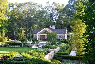 Traditional Landscape/Yard with Fence, Wintergreen Boxwood, Raised beds, French doors, exterior tile floors, Pathway