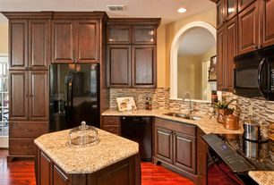 Traditional Kitchen with Raised panel, Framed Partial Panel, Built In Refrigerator, L-shaped, Kitchen island, can lights