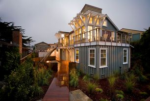 Eclectic Exterior of Home with Wooden pathway, Paint