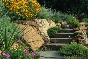 Traditional Landscape/Yard with Pathway, Fence, exterior stone floors, Raised beds