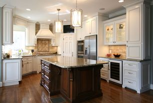 Traditional Kitchen with Crown molding, Cylinder pendant light outer metal shade, U-shaped, Simple granite counters