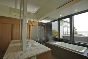 Modern Master Bathroom with Wall Tiles, Casement, drop in bathtub, Undermount sink, Bathtub, stone tile floors, Rain shower
