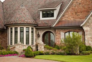 Traditional Exterior of Home with picture window, Pathway, French doors, Raised beds
