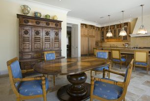 Eclectic Dining Room with can lights, limestone tile floors, Crown molding, stone tile floors, Standard height