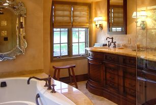Mediterranean Master Bathroom with Standard height, Undermount sink, drop in bathtub, Flush, Simple marble counters, Casement