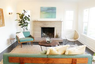 Eclectic Living Room with Wall sconce, Fireplace, Albion burl slice tables, Mid century modern arm chair, Standard height