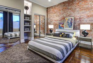 Contemporary Guest Bedroom with West elm mod stripe duvet cover, interior brick, Crown molding, Built-in bookshelf