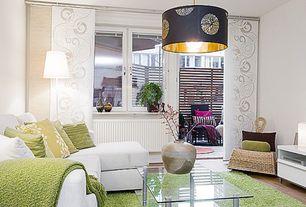 Contemporary Living Room with Standard height, Hardwood floors, Pendant light, Casement