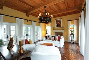 Traditional Living Room with terracotta tile floors, Rivercrest Chandelier, French doors, Exposed beam, Cement fireplace
