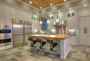 Traditional Kitchen with Ceramic Tile, complex marble tile floors, Wood counters, Soapstone counters, Bar stools, Glass panel