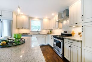 Traditional Kitchen with L-shaped, Crown molding, Framed Partial Panel, gas range, Specialty Tile, Undermount sink, Wall Hood