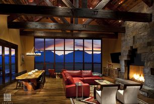 Contemporary Great Room with Pendleton gatekeeper rug, Built-in bookshelf, Chandelier, stone fireplace, Exposed beam