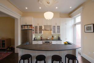 Traditional Kitchen with Slate counters, Kitchen island, Transom window, Breakfast bar, Hardwood floors, Flush, Glass panel